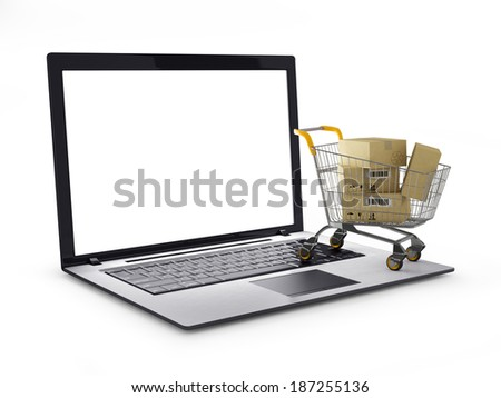 Laptop with small shopping cart - stock photo