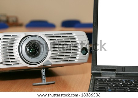 Laptop with the projector on office table