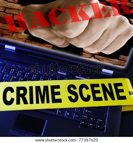 laptop  with yellow crime scene tape across and hacker fist  - stock photo
