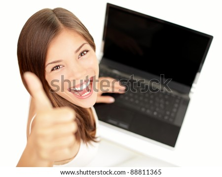 Laptop woman happy giving thumbs up success sign sitting at computer PC with excited face expression. Beautiful smiling cheerful multiracial Asian Caucasian student girl on white background.