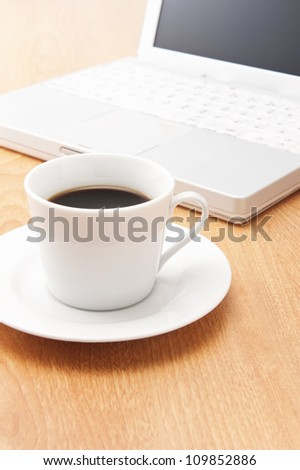Laptops and coffee on the desk - stock photo