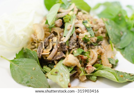 Larb chicken salad. Traditional Thai food, with ground chicken lime, chili and herbs. This food is popular in the north-east of the country