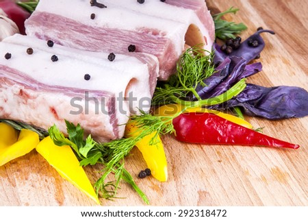 lard bacon with vegetables and herbs
