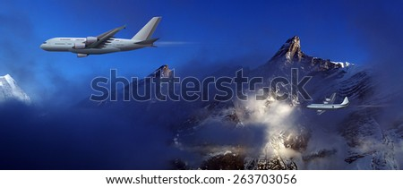 large aircraft and small plane on a background of high mountains