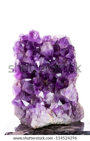 Large amethyst standing on a marble base. Isolated. - stock photo