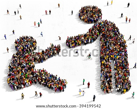 Large and diverse group of people seen from above gathered together in the shape of helping gesture - stock photo