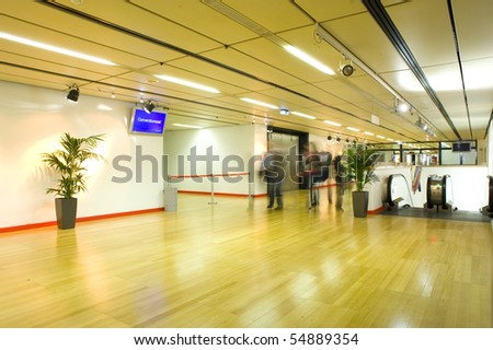 Large and new conference/meeting  hall with blur people in image and a escalator on the side - stock photo