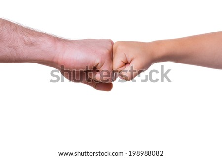 Large and small. Close-up of adult and child fists together and isolated on white