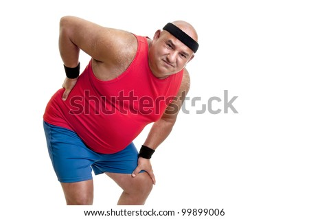Large and tired fitness man with back pain isolated in white - stock photo
