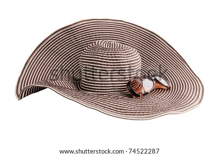 Large beach hat and glasses from the sun - stock photo