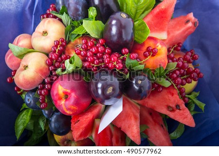 Large beautiful bouquet of fruit, made in red and lilac tone