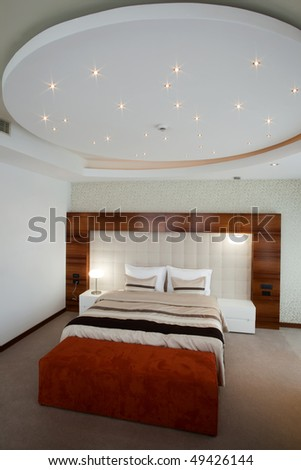 large bedroom with oval ceiling - stock photo