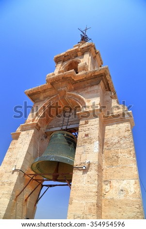 Large bell on top of the belfry of the Metropolitan Cathedral (Basilica of the Assumption of Our Lady of Valencia / Saint Mary's Cathedral / Valencia Cathedral), Valencia, Spain - stock photo