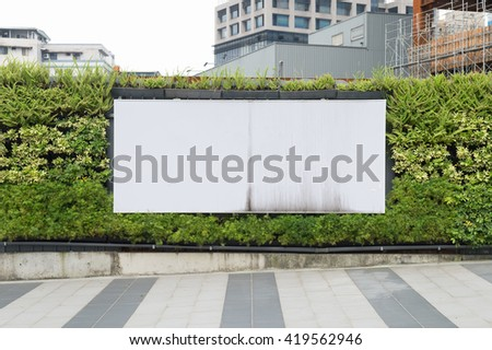 Large blank billboard on a street wall, banners with room to add your own text - stock photo