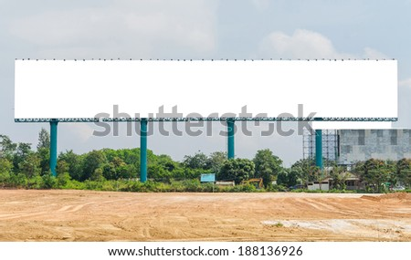 large Blank billboard ready for new advertisement and blue sky. - stock photo