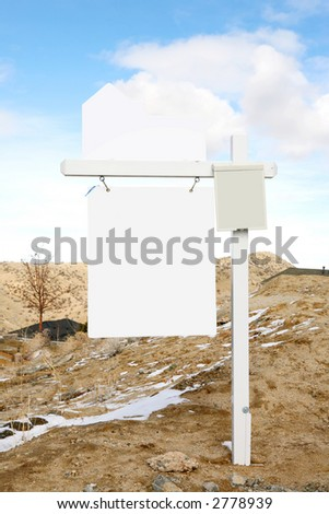 Large blank real estate for sale sign on dirt - stock photo