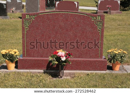 Large Blank Tombstone with Flowers - stock photo