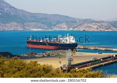 large boat load in a small port - stock photo