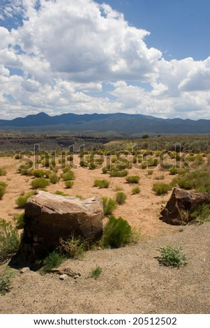 large boulders dot an otherwise desert landscape