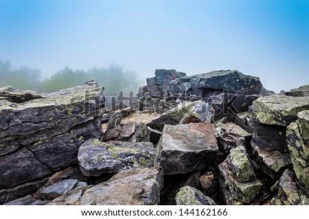 Large boulders in fog on Blackrock Summit, in Shenandoah National Park, Virginia. - stock photo