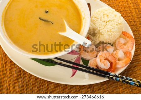 Large bowl of Thai Coconut Soup (Tom Kha Phak) served with steamed rice and shrimp.  Bamboo design on Oriental Platter with chopsticks. - stock photo