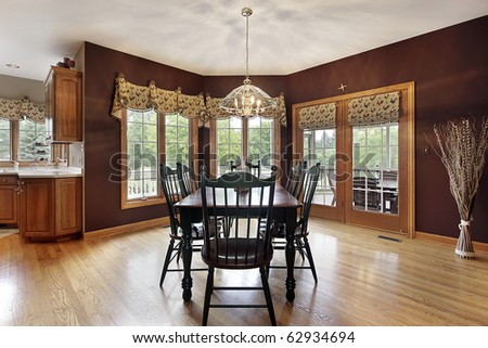 Large breakfast area in suburban home with doors to deck - stock photo