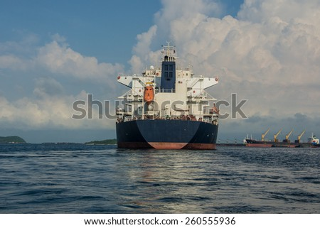 large bulk carrier ships in harbor. - stock photo