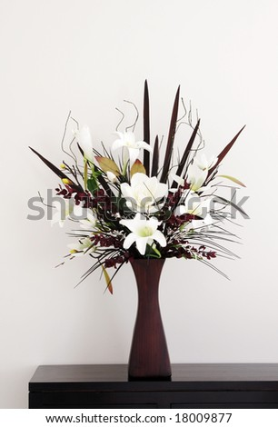 Large Bunch Of Artificial Flowers On A Wooden Side Table, Home Decoration