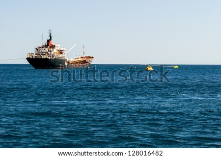 Large cargo ship at sea parked