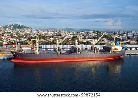 Large cargo ship in a harbor of Mazatlan, Mexico - stock photo
