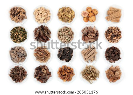 Large chinese herbal medicine selection in china bowls over white background. - stock photo