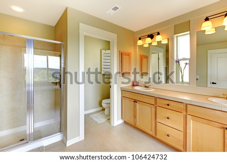 Large classic beautiful bathroom with double sink and shower. - stock photo