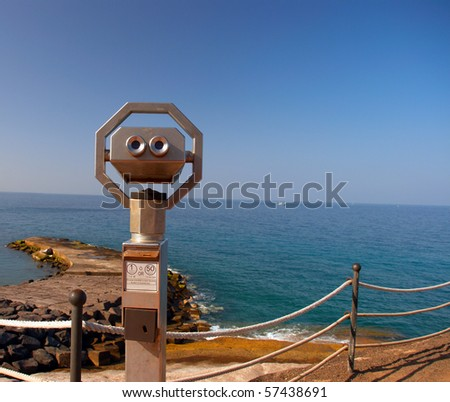 Large coin operated binocular looking at the Atlantic Ocean. Coast of Tenerife Island, Canaries, Spain. - stock photo