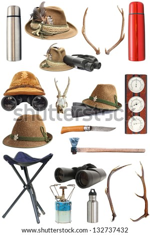 large collection of hunting and outdoor traditional equipment over white background - stock photo