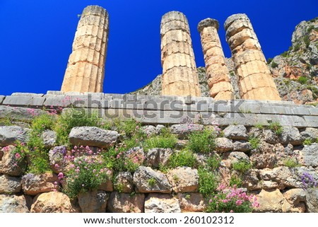 Large columns of the sun god Apollo's temple in sunny day, Delphi, Greece - stock photo