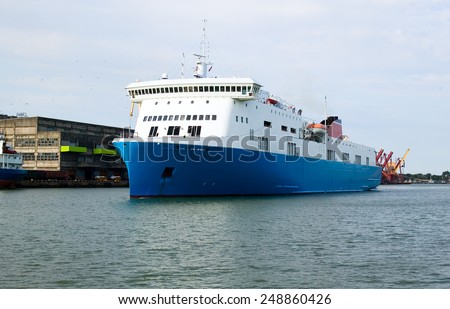 Large commercial freighter in a harbor, transport concept - stock photo