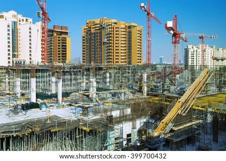 Large construction site in quickly developing Dubai city,Dubai,United Arab Emirates - stock photo