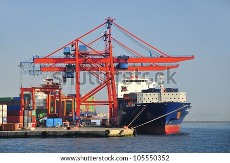 Large container ship in a dock at port - stock photo