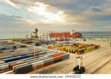 large container ship leaving the container port terminal (no trademarks visible) - stock photo