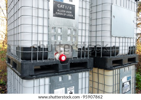 large containers for chemical fluids - stock photo