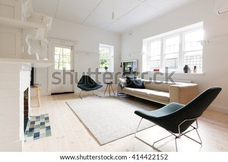 Large contemporary interior styled living room in Melbourne apartment - stock photo