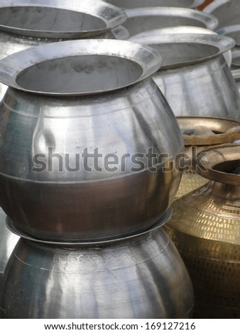 Large cooking and water pots  at the weekly market  in Kunduli, Orissa in India
