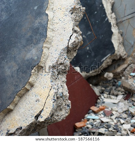 large crack in the house in ruins - wall of house destroyed during earthquake - stock photo
