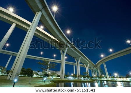 Large crossing elevated  traffic highway in the night time