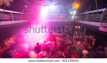 Large crowd in the disco club - stock photo