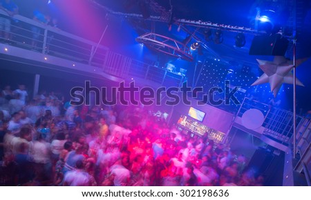 Large crowd in the night club - stock photo