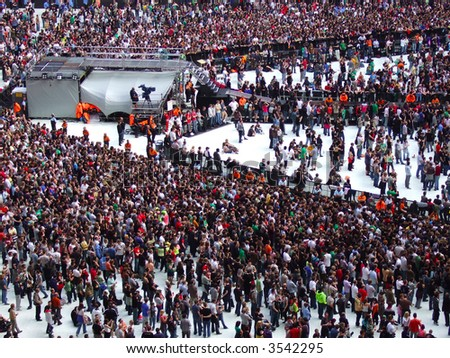 Large crowd of people waiting for a gig to start - stock photo