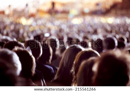 Large crowd of people watching concert or sport event - stock photo