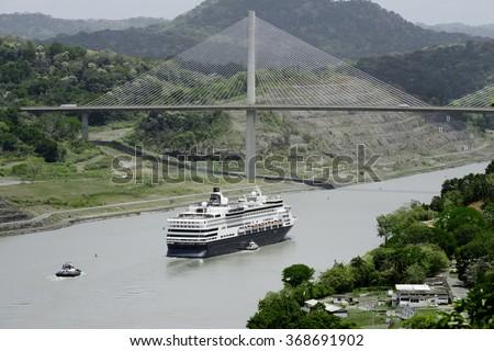 Large cruise ship passing under Panama's Centennial Bridge, Panama Canal - stock photo