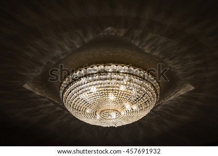 large crystal chandelier in the concert hall - stock photo